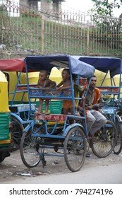 New Delhi India June 24 2013 Bicycle taxi waiting for clients Children in the back having fun