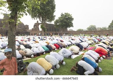New Delhi, India, June 26, 2017- Muslim people praying at a celebration of Id-Ul-Fitr at Feroz Shah Kotla today morning.