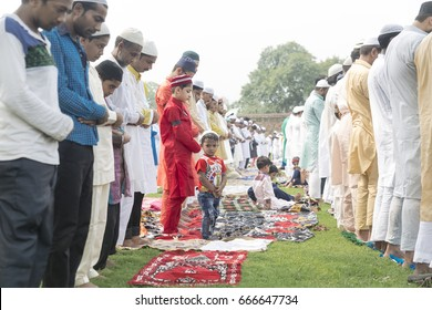 New Delhi, India, June 26, 2017-A young boy is looking outside while people from Muslim community are in que at prayer meeting at Feroz Shah Kotla to celebrate Id-Ul-Fitr.