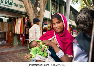 NEW DELHI, INDIA - MARCH 17 : Indian woman beggar or untouchable caste hold baby and begging money from travelers people at Janpath Market and Dilli Haat bazaar on March 17, 2019 in New Delhi, India