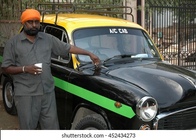 NEW DELHI, INDIA - MARCH 20, 2006: A small New Delhi taxi, with his Sikhs driver