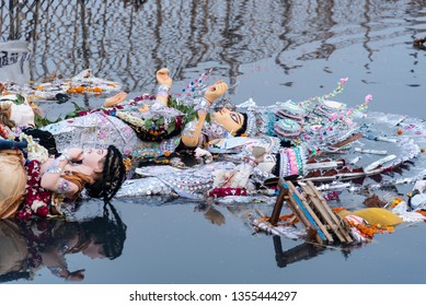 New Delhi, India - March 26, 2019: An idol of Godess Durga in the polluted river Yamuna water.