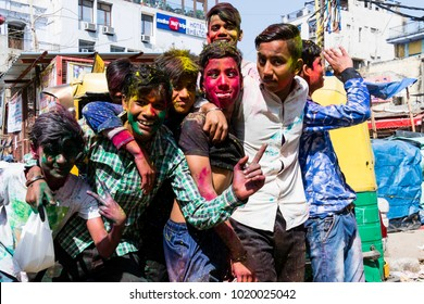New Delhi, India, March 3 2017: Teenager celebrating the famous and coloful Holi Festival in New Delhi, India