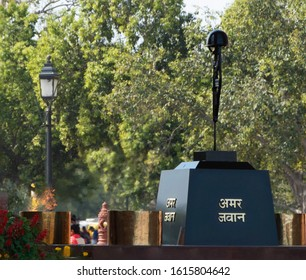 """New Delhi, India - March 6th 2019: The flame of Amar jawan jyoti signifying immortality burns at the India Gate, New Delhi""."