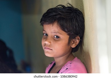New Delhi, India - May 08, 2018: A young poor girl looking lonely from her face expression.