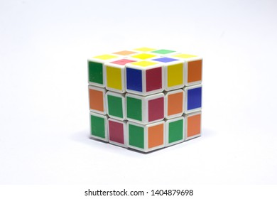 New Delhi, India - May 10, 2019. Rubik's cube color blue, white, orange, green, yellow on white background with space for text