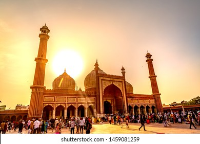 NEW DELHI, INDIA - May 14 2019: Tourists and pilgrims pray in Jama Masjid mosque . Jama Masjid the largest  mosque in India