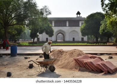 NEW DELHI / INDIA - MAY 2019: Indian people are working in renovation project, on more than 350 years old Red Fort, main residence of the emperors of Mughal dynasty. Renovation of Red Fort or Lal Qila
