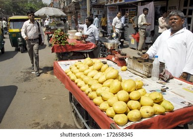 NEW DELHI, INDIA - MAY 23: Unidentified street vendor sells mangoes on a Main Bazaar street on May 23, 2009 in New Delhi, India. May is mangoes picking season in India.