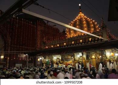 NEW DELHI, INDIA. MAY 23,2018: People read prayers in the premises of Hazrat Nizamuddin Dargah Complex, after the Iftar ceremony, the evening meal to break the fast during the holy month of Ramadan.