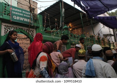 """NEW DELHI, INDIA. MAY 23,2018. : People line up for free distribution of food items at the Hazrat Nizamuddin Dargah Complex, Delhi to break their fast after sunset - """"Iftar"""", in holy month of Ramzan."""