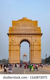 NEW DELHI, INDIA - NOV 14, 2011: people visit famous india gate in Delhi.