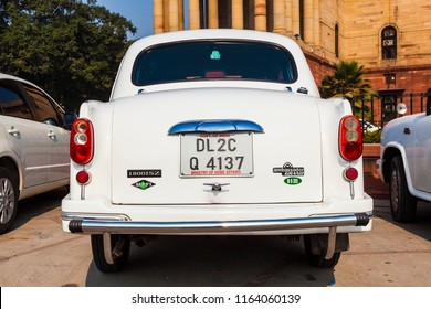 NEW DELHI , INDIA - NOV 17, 2011: Official Hindustan Ambassador cars park outside North Block, Secretariat Building in Delhi, India. The production started in 1958 on base of the Morris model.