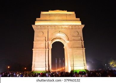 NEW DELHI, INDIA, NOVEMBER 07, 2014: India Gate in New Delhi by night. Tourists throng to see the floodlit monument in the night.