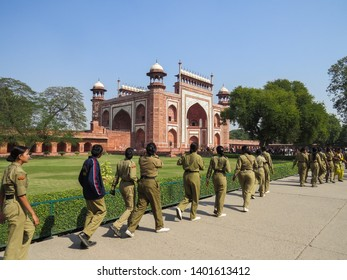 New Delhi, India, November 21, 2013. Girls in uniform go to the entrance to the Red Fort, a historic fort in the city. It was the main residence of the emperors of the Mughal dynasty