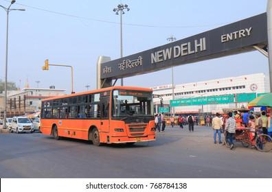 NEW DELHI INDIA - NOVEMBER 25, 2017: New Delhi city bus runs in front of New Delhi train station.