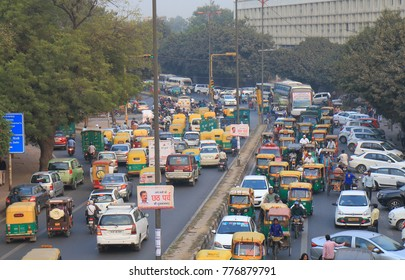 NEW DELHI INDIA - NOVEMBER 28, 2017: Unidentified people commute in downtown New Delhi.