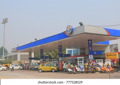 NEW DELHI INDIA - NOVEMBER 29, 2017: Unidentified people buy petrol at HP petrol station. Hindustan Petroleum HP is Indian state owned oil and natural gas company headquartered in Mumbai.