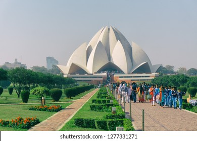 NEW DELHI, INDIA - November 30, 2018: People visiting the Lotus Temple in New Delhi on a sunny day.