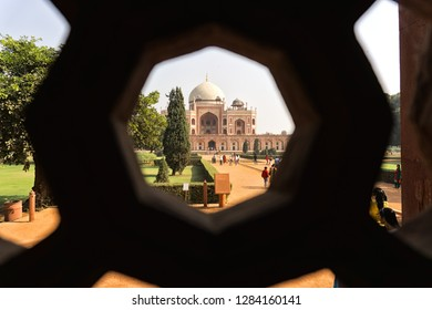 NEW DELHI, INDIA - November 30, 2018: Humayun's tomb from the viewfinder of a window, New Delhi, India.