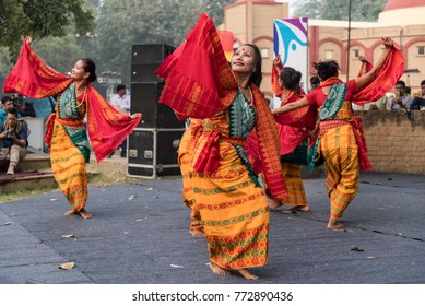 New Delhi, India - November 30, 2017: Group of girls from north eastern states dancing wearing ethnic dresses.
