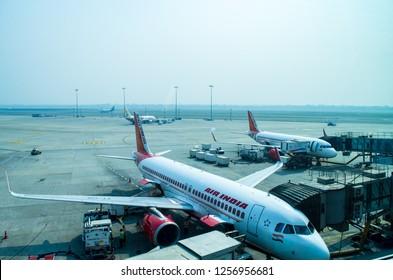 New Delhi, India -Oct 2018- Aeroplanes at Delhi International Airport. Indira Gandhi International Airport serves as the primary civilian aviation hub for the National Capital Region of Delhi, India