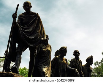 New Delhi, India - October 10th, 2016: Statue of Mahatma Gandhi leading his followers, during Dandi March movement in 1930, one of the most important events during India's struggle for independence