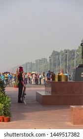 NEW DELHI, INDIA - OCTOBER 30 2016: A soldier standing guard at The Amar Jawan Jyoti (the flame of the immortal warrior), India Gate