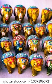 New Delhi, Delhi / India - September 30, 2018 : Miniature Hand made clay Elephants made by artisians in India