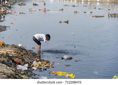New Delhi, India - September 4, 2017: Very poor condition of river Yamuna. The river has been declared dead. Young kids using the water which can cause disease and illness