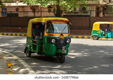 New Delhi, India,2019. Emphatic looking CNG fueled autorickshaw, standing on the corner of the road.Its a popular urban transport on Indian roads in Mumbai, Pune, Lucknow, Jaipur, Hyderabad, Bangalore