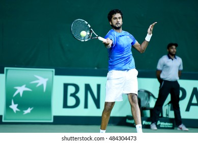 NEW DELHI - SEPTEMBER 16, 2016: Saketh Myneni of India plays against David Ferrer of Spain in the second singles match of Davis Cup World Group Play Off tie at R.K. Khanna Tennis Stadium, New Delhi.
