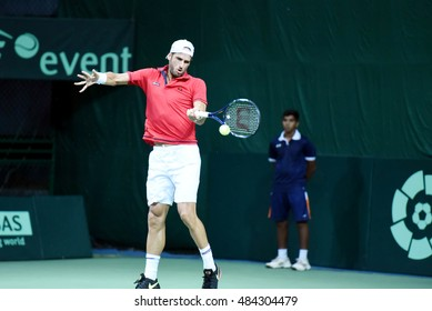 NEW DELHI - SEPTEMBER 16, 2016: Feliciano Lopez of Spain plays against Ramkumar Ramanathan of India in singles match of Davis Cup World Group Play Off tie at R.K. Khanna Tennis Stadium, New Delhi.