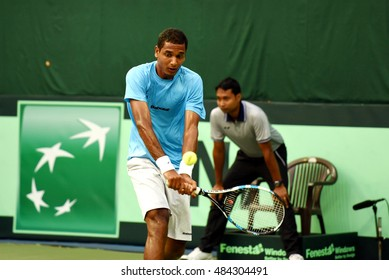 NEW DELHI - SEPTEMBER 16, 2016: Ramkumar Ramanathan of India plays against Feliciano Lopez of Spain in singles match of Davis Cup World Group Play Off tie at R.K. Khanna Tennis Stadium, New Delhi.