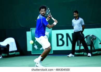 NEW DELHI - SEPTEMBER 16, 2016: Saketh Myneni of India plays against David Ferrer of Spain in the second singles match of Davis Cup World Group Play Off tie at R.K. Khanna Tennis Stadium, New Delhi.