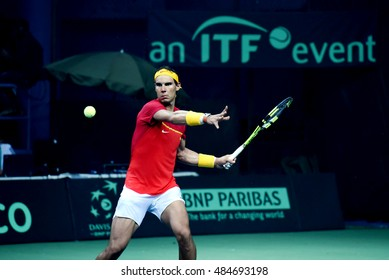 NEW DELHI - SEPTEMBER 17, 2016: Rafael Nadal plays for Spain against India in the Davis Cup 2016 doubles match at R.K. Khanna Tennis Stadium, New Delhi.