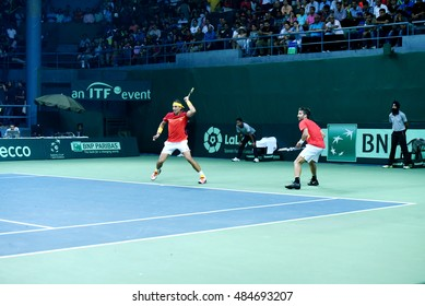 NEW DELHI - SEPTEMBER 17, 2016: Rafael Nadal and Marc Lopez play for Spain against India in the Davis Cup 2016 doubles match at the R.K. Khanna Tennis Stadium, New Delhi.