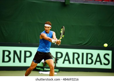 NEW DELHI - SEPTEMBER 17, 2016: Rafael Nadal practices before the Davis Cup 2016 doubles match between India and Spain at the R.K. Khanna Tennis Stadium, New Delhi.
