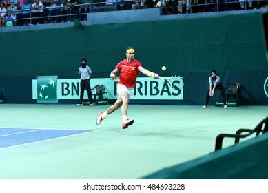 NEW DELHI - SEPTEMBER 17, 2016: Rafael Nadal plays for Spain against India in the Davis Cup 2016 doubles match at R.K. Khanna Tennis Stadium, New Delhi.