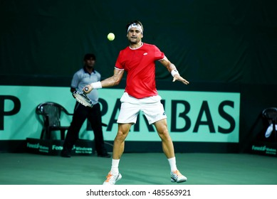 NEW DELHI - SEPTEMBER 18, 2016: David Ferrer of Spain plays against Ramkumar Ramanathan of India in the second reverse singles of the Davis Cup World Group play off round in New Delhi.