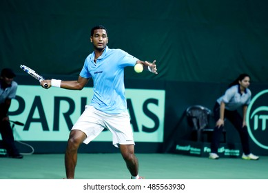 NEW DELHI - SEPTEMBER 18, 2016: Ramkumar Ramanathan of India plays against David Ferrer of Spain in the second reverse singles of the Davis Cup World Group play off round in New Delhi.