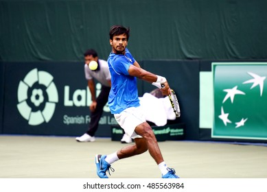 NEW DELHI - SEPTEMBER 18, 2016: Sumit Nagal of India plays against Marc Lopez of Spain in the first reverse singles of the Davis Cup World Group play off round in New Delhi.