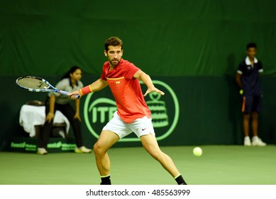 NEW DELHI - SEPTEMBER 18, 2016: Marc Lopez of Spain plays against Sumit Nagal of India in the first reverse singles of the Davis Cup World Group play off round in New Delhi.