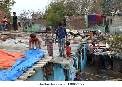NEW DELHI,INDIA-FEBRUARY 4:children not unidentified play on the rooftops of the l slum in New Delhi.50% of the population of New Delhi is thought to live in slums,on February 4,2013 in New Delhi