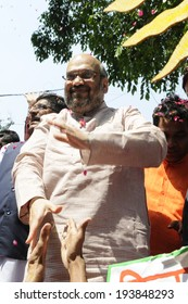 NEW DELHI-MAY 16:  Amit Shah the general secretary of the BJP party being congratulated by supporters  after BJP won the Indian National election on May 16, 2014 in New Delhi , India.
