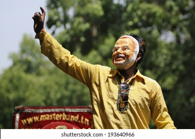 NEW DELHI-MAY 16:  A BJP supporter wearing a Modi mask after wining the Indian National election on May 16, 2014 in New Delhi , India.