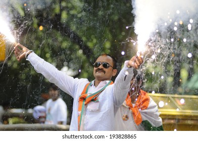 NEW DELHI-MAY 16:   A BJP supporter  lighting a firecracker  after BJP party  won the Indian National election on May 16, 2014 in New Delhi , India.