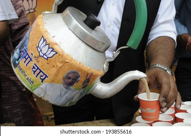"""NEW DELHI-MAY 16:  A BJP supporter pouring """"Namo chai"""" - to remember the fact that Modi was tea vendor ,while celebrating BJP's win of  Indian National election on May 16, 2014 in New Delhi , India."""