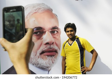 NEW DELHI-MAY 16:  A BJP worker taking picture of himself  in front of a Narendra Modi picture after BJP won the Indian National election on May 16, 2014 in New Delhi , India.