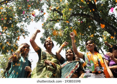 NEW DELHI-MAY 16: Women  BJP supporters chanting slogans  while celebrating BJP's win of  Indian National election on May 16, 2014 in New Delhi , India.